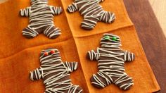 Wrap up your party with these spooky treats, flavored fast with instant coffee and drizzled with melted vanilla chips.
