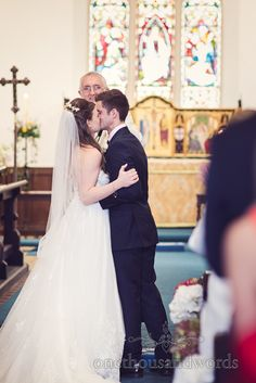 First kiss from wedding at Sopley Mill. Photography by one thousand words wedding photographers