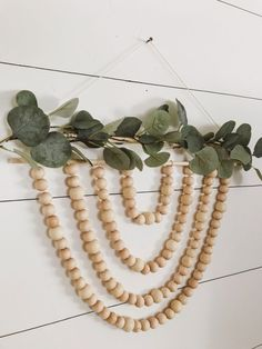 I've been really loving neutral wood wall hangings, especially with a modern boho style. I decided to make one of my own, and this is what I came up with. Yarn Wall Hanging, Hanging Plants, Wall Hangings, Diy Hanging, Hanging Garland, Wood Bead Garland, Beaded Garland, Wood Wreath, Boho Diy