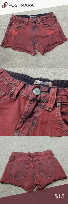 Free People Distressed Washed Shorts Rustic red. Very beautiful color. 100% Cotton Pre-owned Cut-off style shorts . Has pockets in front and back Women's size 24 Free People Shorts Jean Shorts