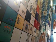 Tshirts in a drop down tile ceiling. Love this idea!