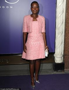 Pretty in pink: Looking the absolute epitome of ladylike chic, the 30-year-old screen starlet radiated effortless style in a candy pink tweed two-piece
