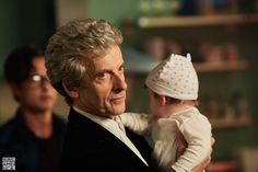 """alliwantisyouandme: """"The Doctor with a new human. The Doctor holding a baby. Peter Capaldi aND A BABY """""""