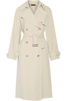 The Row's trench coat is cut from soft cotton-canvas. This 'Romtin' style has a classic double-breasted silhouette, storm flap, buckled cuffs and belt. Embrace the season's penchant for tonal dressing and wear yours with tailored cream pants.