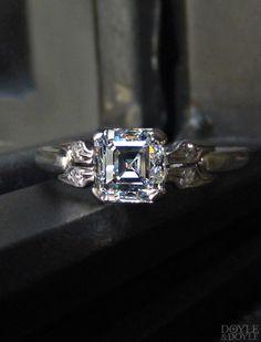Vintage Art Deco asscher cut diamond engagement ring in platinum. Circa 1935, from Doyle & Doyle.
