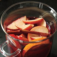 Apple Sangria Recipe Beverages, Cocktails with apples, apple schnapps, honey, clove, cinnamon sticks, peeled fresh ginger, navel oranges, red wine, club soda, apples