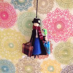 The Magical Mary Poppins and her parrot head umbrella! She measures 4 3/4 inches tall Thank you for looking