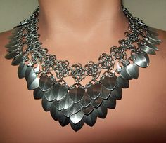 This choker combines chainmaille and scales for a sexy look. I wove the choker using the euro 4 in 1 weave, and added points to the top and bottom for a Wire Jewelry, Jewelry Crafts, Jewelry Box, Silver Jewelry, Jewelry Accessories, Jewelry Necklaces, Handmade Jewelry, Jewelry Design, Jewelry Making