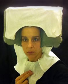 """Airplane Lavatory Self-Portraits in the Flemish Style BY EDW LYNCH ON APRIL 10, 2012 To pass the time during long flights, artist Nina Katchadourian goes to the lavatory, adorns herself in tissue paper costume, and creates self-portrait photos in the style of Flemish Renaissance paintings. She calls the series """"Seat Assignment: Lavatory Self-Portraits in the Flemish Style."""""""