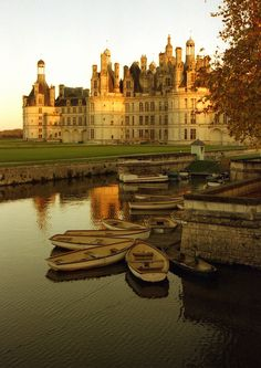 Château de Chambord, France So picturesque - love the skiffs alongside of the gorgeous Chateau!