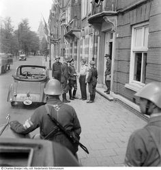 May 7, 1945. OD-group Stanz of the NBS during the surrender of Kommandantur in the Southern section of Amsterdam. In the photo: Ben Warners, Oberst Leutnant Schroeder, Max van Raalte, 2 unknown German soldiers and 2 S.T.A.N.Z.-members. Photo Charles Breijer #amsterdam #worldwar2