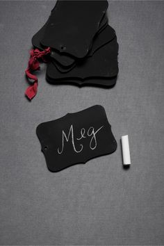 Chalkboard Tags from BHLDN's new decorations collection, which is full of scalloped edges and floral motifs