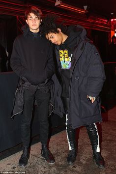 Anwar hangs out with fellow model Luka Sabbat just outside the event Tuesday night...