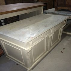 This lovely item adds hidden cabinet storage and a functional workspace with the marble top. Lots of character. Such a beauty.