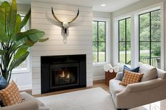 Shiplap Fireplace Wall - Design photos, ideas and inspiration. Amazing gallery of interior design and decorating ideas of Shiplap Fireplace Wall in bedrooms, living rooms, decks/patios by elite interior designers. Fireplace Remodel, Farmhouse Windows, Fireplace Surrounds, Living Room With Fireplace, Ship Lap Walls, Foyer Decorating, White Shiplap Wall, Farmhouse Fireplace, Farmhouse Fireplace Decor