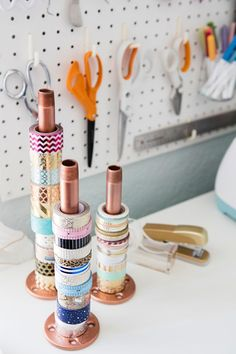 Use copper pipe to organize rolls of washi tape. Such a good idea.