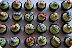 Bug cupcakes using m&ms and sweets.   Melt chocolate bits and pipe the body shape and legs on baking paper, add sweets. Allow to dry and carefully add to iced cupcakes.  Brilliant boys cupcakes!!!