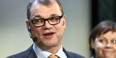 Juha Sipilä, taustalla Paula Lehtomäki (kesk). Arkistokuvaa.
