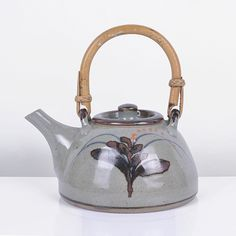 DAVID LEACH (British: 1911-2005) - Teapot, 1990 - Stoneware, pale green glaze with an iron and cobalt blue painted foxglove motif
