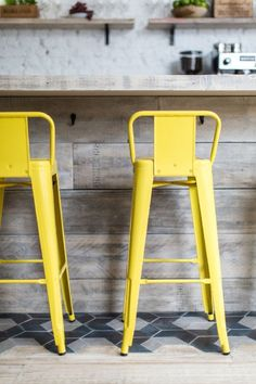 A Californian Beach House-Inspired Hangout In London 9, bright yellow metal stools, reclaimed weathered wood, pantone meadowlark, lemon yellow, bright yellow