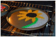 SUNFLOWER MELTED PONY BEADS  ~ Going to have to try this for a peace sign.