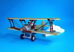 Miro Dudas has given us what we never knew we needed: Snoopy in his warbird. The Sopwith Camel itself is fantastic, and the addition of Snoopy as pilot just tugs at nostalgia. Lego Tv, Lego Books, Cool Lego, Cool Toys, Lego Plane, Lego Universe, Lego Pictures, Flying Ace, Lego Mecha