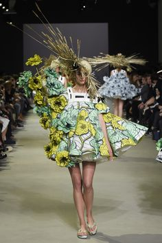 """""""The quintessential summer look: a floral dress, a straw hat and flip-flops,"""" Rolf Snoeren said, enumerating the three ingredients for the Viktor & Rolf spring couture show.  [Photo by Giovanni Giannoni]"""