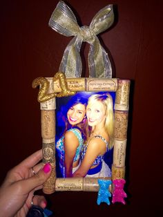 Wine corks, cardboard, hot glue, modeling clay, and glitter!! 21st birthday gift for my gummy bear bestfriend!