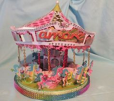 #SVGcuts cupcake carousel, blinged up!  Horses hung on chains rather than stuck in cupcakes.  Lots of bling