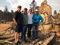 The Flying W Wranglers (Tony, David, Zach & Wayne) stand on the outdoor stage at the Flying W Ranch.     The site is overwhelming.
