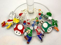 This is a set of 6 handmade Super Mario inspired wine charms. They are made with swarovski crystal elements and glass seed beads.Perfect gift for a Super Mario fan.