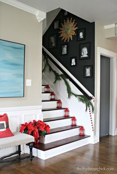 I made a bold choice and painted our stairwell wall black...and I love it! @Thriftydecorchick