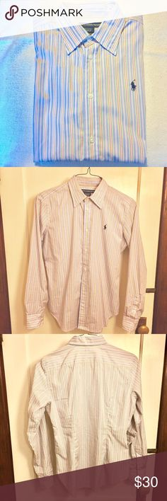 NWOT Monogrammed striped cotton shirt With a no-iron finish, this slim-fit cotton poplin shirt maintains its crisp, wrinkle-free look from your morning meeting to your evening cocktails. Colors resemble the last picture best. Stripes are pink, yellow, white and blue. Point collar. Buttoned placket. Long sleeves with buttoned barrel cuffs. Shirttail hem. Back yoke. 100% cotton. Machine washable. Imported. NWOT Ralph Lauren Tops Blouses