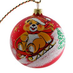 cub on a sled glass christmas ornament red