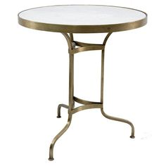 table dorée en marbre doré elva
