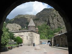 The monastery of Geghard (Armenian: Գեղարդ, meaning spear) is a unique architectural construction in the Kotayk province of Armenia, being partially carved out of the adjacent mountain, surrounded by cliffs.