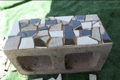 Here is a cool idea for beautifying cinder blocks to create a mosaic boarder. Mosaic one flat side of the block, then place hole side down. Line them up to create a border and also fill the holes for planting.
