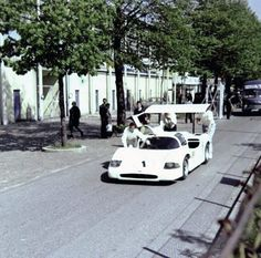 Crew members push the Chaparral 2F in the paddock at Monza, 1967. The 2F would cause Italians to stop at stare at the car. Nothing like it had been seen before.