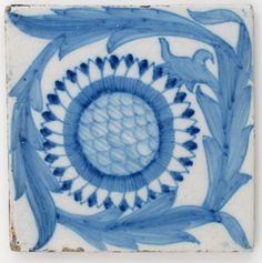 A Sunflower pattern Dutch tin-glazed tile designed by William De Morgan or William Morris, probably retailed by Morris & Co, glazed in blue and white unsigned 15cm, square Literature Richard & Hilary Myers William Morris Tiles, Richard Dennis Publications, page 105 figure 165 for comparable tiles,