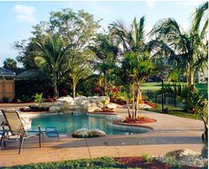 Tropical Pool Landscape with Real Rock Pool Coping Better 49 Pool Landscaping with Rocks Tropical Pool Landscaping, Landscaping With Rocks, Backyard Landscaping, Backyard Ideas, Pool Ideas, Rustic Outdoor Bar, Simple Pool, Pool Images, Pool Coping