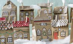 Schnell gemacht und ein echter Blickfang: Die Adventskalender-Stadt aus bemalten Papiertüten