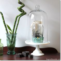 Upcycled glass jar with a postcard, marbles, and a tealight. #DIY #masonjar #upcycling