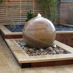 Water features on pinterest wall fountains garden for Sphere garden design