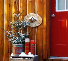 Cabin Christmas Decor - camp and cottage living -- small flocked tree in a metal bucket Cabin Christmas Decor, Winter Porch Decorations, Christmas Lodge, Christmas Porch, Primitive Christmas, Country Christmas, Christmas Decorations, Tartan Christmas, Primitive Decor