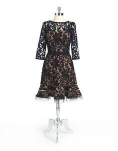 """A luxurious, lacy pattern and sheer mesh insets define this elegant, flared silhouette.<ul><li>Boatneck</li><li>Three-quarter sleeves</li><li>Flared hemline with mesh insets</li><li>Concealed back zip</li><li>Fully lined</li><li>About 26"""" from natural waist</li><li>Cotton/nylon</li><li>Dry clean</li><li>Imported</li></ul><br>Model shown is 5'10"""" (177cm) wearing US size 4."""