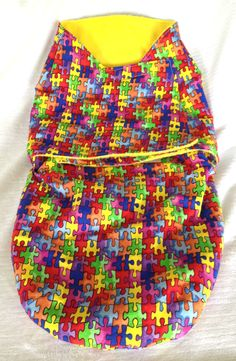 Baby Snuggler, Outer shell fabric is 100% cotton and the inside is fleece, Swaddle your newborn. Autism Awareness Inspired