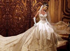 This is the most Beautiful wedding dress I ever seen it has a gourgose long train and Beautiful sequeins and the satin gloves pull the dress together and her bail is Beautiful it's long and dealaget it a Beautiful dress LOVE IT.
