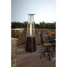 Tall Glass Tube Patio Heater in Hammered Bronze Outdoor Heaters Patio, Propane Patio Heater, Fire Pit Patio, Outdoor Living, Outdoor Decor, Outdoor Spaces, Outdoor Furniture, Outdoor Entertaining, Lawn And Garden