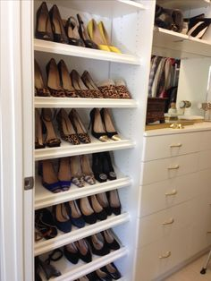 The best way to organize show is by making sure each pair is visible. The can be achieved by creating a shoe wall. The angled shelves make it even easier to see each pair. Designed by California Closets Twin Cities.