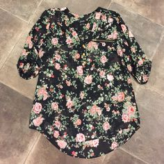 Floral top Cute floral top. Gold button and zipper detail on front and buttons on sleeves. 100% polyester. Excellent condition. Tops Blouses